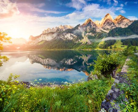 Misty summer sunrise on the Vorderer Gosausee lake. Colorful outdoor scene in Austrian Alps, Salzkammergut resort area in the Gosau Valley in Upper Austria