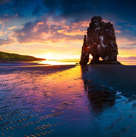 Huge basalt stack Hvitserkur on the eastern shore of the Vatnsnes peninsula. Colorful summer sunrise in northwest Iceland Banco de Imagens