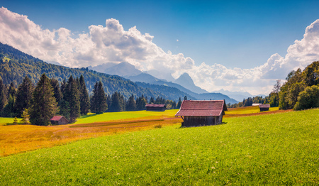 Picturesque view of green meadows near the Kaltenbrunn village with with Zugspitze peak, Wetterstein Mountains, Bavaria, Germany