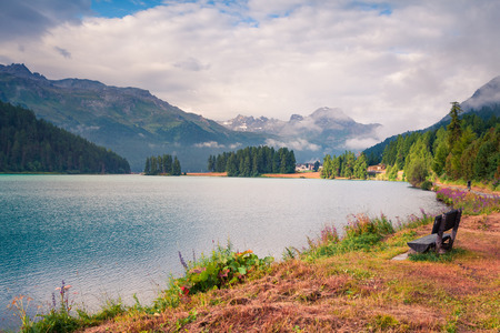 Misty summer landscape of Silvaplana lake. Colorful morning view of Segl village, Maloja pass, Upper Engadine in the Swiss canton of the Grisons, Switzerland Stock Photo