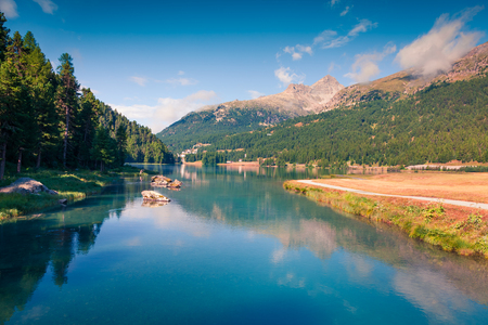 Sunny summer morning on Silvaplana lake. Picturesque outdoor scene in Swiss Alps, Sondrio province Lombardy region, Italy