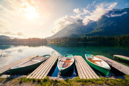 Colorsul summer sunrise on the Hintersee lake with white pleasure launches. Sunny morning scene in Austrian Alps. Salzburg-Umgebung, Austria