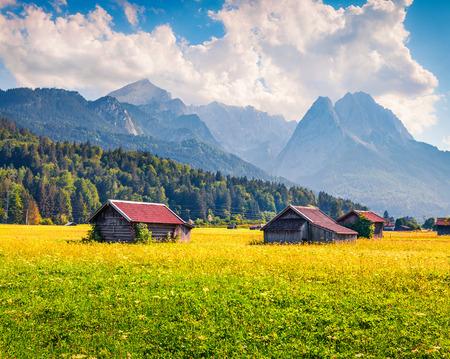 Splendid summer view of Garmisch-Partenkirchen mountain ski resort. Coloful outdoor scene with highest peak of the Wetterstein Mountains, Bavaria, Germany