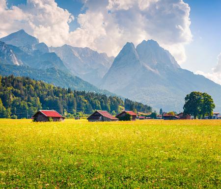 Sunny summer view of Garmisch-Partenkirchen mountain ski resort. Coloful outdoor scene with highest peak of the Wetterstein Mountains, Bavaria, Germany