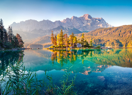 Colorful summer morning on the Eibsee lake with Zugspitze mountain range. Sunny outdoor scene in German Alps, Bavaria, Garmisch-Partenkirchen village location, Germany Stock Photo