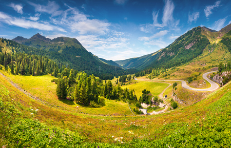 Picturesque summer view of mountain pass road from the Speicher lake. Colorful outdoor scene in western Austrian Alps, in the district of Innsbruck-Land in the state of Tyrol, Austria