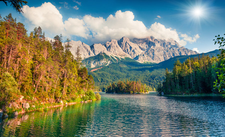 Sunny summer morning on the Eibsee lake with Zugspitze mountain range. Great outdoor scene in German Alps, Bavaria, Garmisch-Partenkirchen village location, Germany