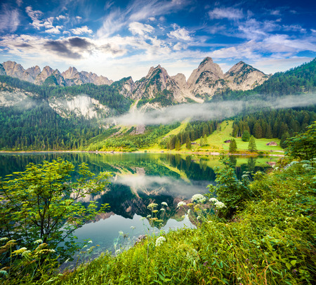 Misty summer morning on the Vorderer Gosausee lake. Colorful outdoor scene in Austrian Alps, Salzkammergut resort area in the Gosau Valley in Upper Austria Stock Photo - 87183591