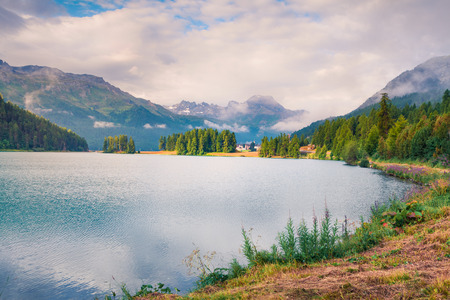 Sunny summer landscape of Silvaplana lake. Colorful morning view of the Segl village, Maloja pass, Upper Engadine in the Swiss canton of the Grisons, Switzerland Stock Photo