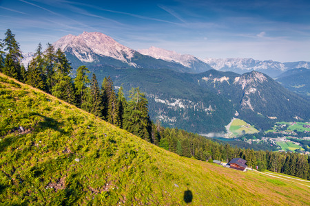 View from cableway cabine above the Konigsee lake on Schneibstein mountain ridge. Colorful summer morning on a border of Germany and Austrian Alps. Berchtesgaden location, Bavaria, Germany