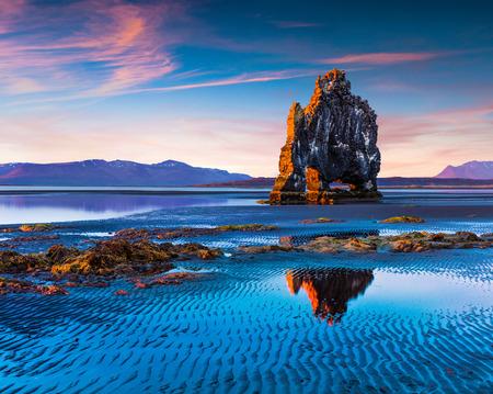 Huge basalt stack Hvitserkur on the eastern shore of the Vatnsnes peninsula. Colorful summer sunrise in northwest Iceland Stock Photo