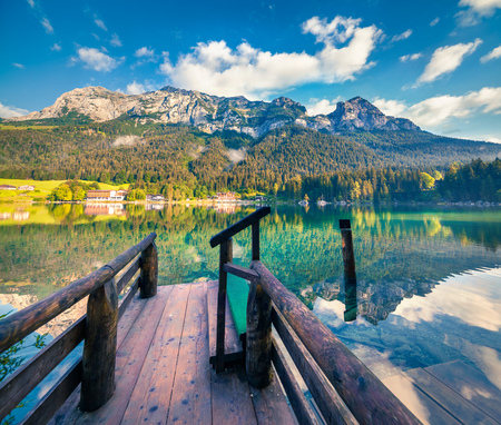 Splendid summer morning on the Hintersee lake with wooden pier. Colorful outdoor scene in the Austrian Alps, Salzburg-Umgebung district, Austria
