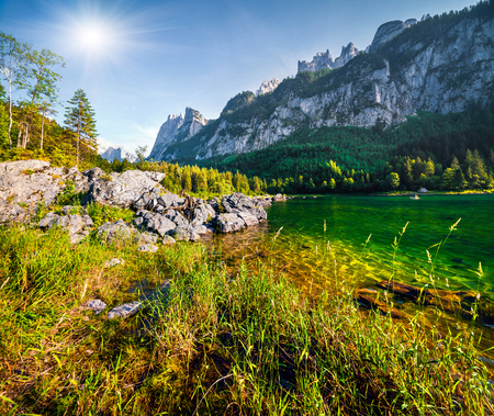 Beautiful summer morning on the Vorderer Gosausee lake. Colorful outdoor scene in Austrian Alps, Salzkammergut resort area in the Gosau Valley in Upper Austria