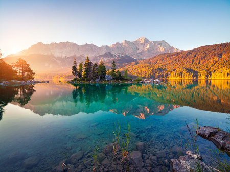 Colorful summer morning on the Eibsee lake with Zugspitze mountain range. Sunny outdoor scene in German Alps, Bavaria, Garmisch-Partenkirchen village location, Germany