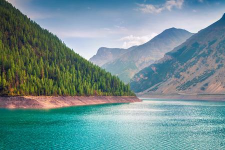 Sunny summer morning on Livigno lake. Splendid outdoor scene in Italian Alps, Sondrio province Lombardy region, Italy