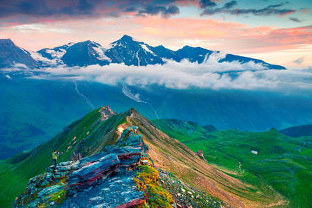 Photographer take a picture of Grossglockner mountain range from Grossglockner High Alpine Road. Colorful sunrise in Austrian Alps, Zell am See district, state of Salzburg in Austria