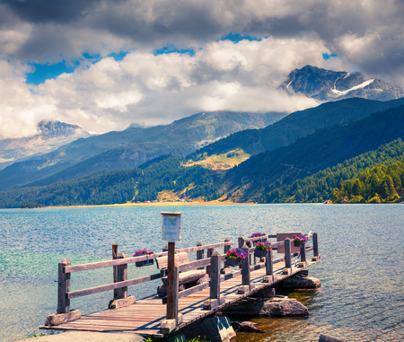 Wooden pier on the Sils lake. Colorful morning view in Swiss Alps, Maloja pass, Upper Engadine in canton of the Grisons, Switzerland