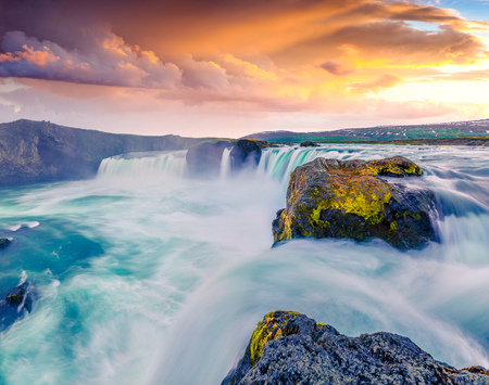 Summer morning scene on the Godafoss Waterfall. Colorful sunset on the on Skjalfandafljot river, Iceland Stock Photo