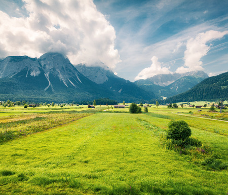 Green meadow on the Golf club Zugspitze, Lermoos village loccation. Colorful summer morning in  Austrian Alps, Reutte district, state of Tyrol, Austria Stock Photo