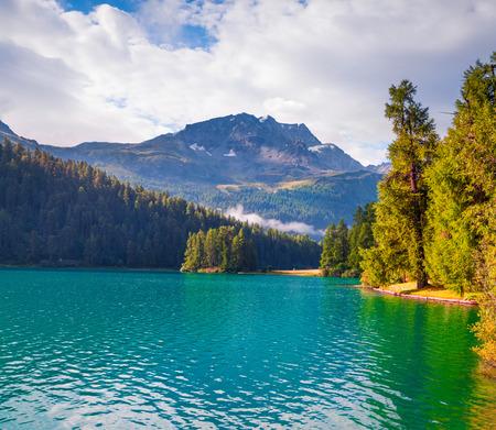 Sunny summer morning on Silvaplana lake. Great outdoor scene in Swiss Alps, Sondrio province Lombardy region, Italy