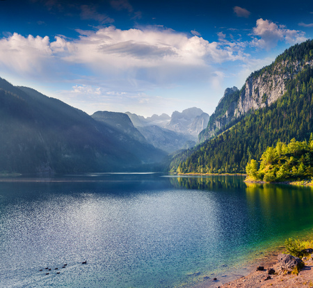 Sunny summer morning on the Vorderer Gosausee lake with view of Dachstein glacier. Colorful outdoor scene in Austrian Alps, Salzkammergut resort area in the Gosau Valley in Upper Austria