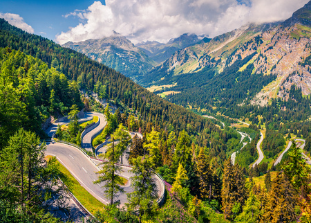 Sunny summer view from the top of Maloja pass. Colorful morning scene in Swiss Alps, Upper Engadine in canton of the Grisons, Switzerland
