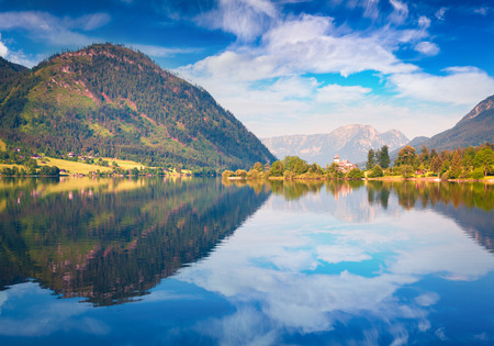 Bright sunny view of Gessl village. Colorful summer morning on the Grundlsee lake, Liezen District of Styria, Austria, Alps. Europe. Artistic style post processed photo.