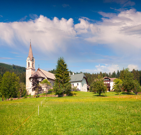 Bright sunny morning in Gosau village with Christianity churh. Colorful outdoor scene in Austrian Alps, Liezen District of Styria, Austria. Europe. Artistic style post processed photo.