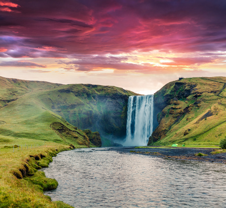 Dramatic summer view of Skogafoss Waterfall on Skoga river. Colorful summer sunrise in Iceland, Europe. Artistic style post processed photo. Reklamní fotografie
