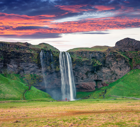 Fantastic morning view of Seljalandfoss Waterfall on Seljalandsa river. Colorful summer sunrise in Iceland,  Europe. Artistic style post processed photo. Reklamní fotografie