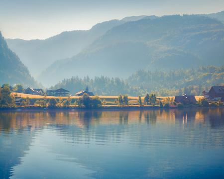 Misty morning on Grundlsee lake. Beautiful summer view of Gessl village, Liezen District of Styria, Austria, Alps. Europe. Artistic style post processed photo. Reklamní fotografie