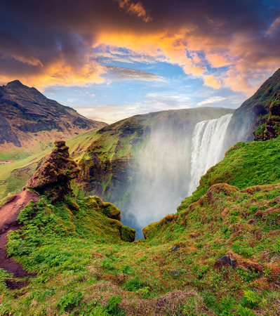 Picturesque  morning view of Skogafoss Waterfall on Skoga river. Dramatic summer sunrise in Iceland, Europe. Artistic style post processed photo.