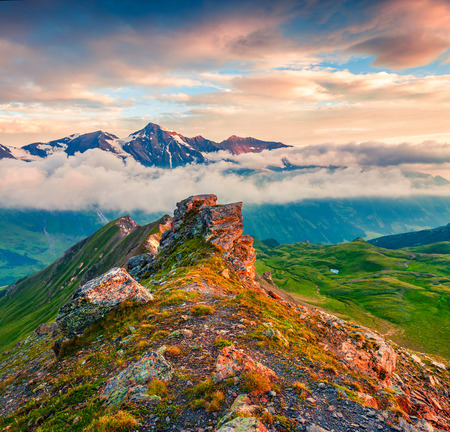 Summer morning view of Grossglockner mountain range from Grossglockner High Alpine Road. Colorful sunset in Austrian Alps, Zell am See district, state of Salzburg in Austria, Europe. Artistic style post processed photo.