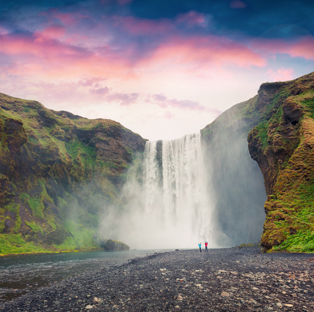 Great morning view of Skogafoss Waterfall on Skoga river. Colorful summer sunrise in Iceland, Europe. Artistic style post processed photo.