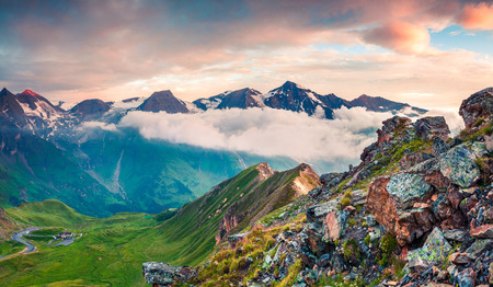 Summer morning view of Grossglockner mountain range from Grossglockner High Alpine Road. Colorful sunrise in Austrian Alps, Zell am See district, state of Salzburg in Austria, Europe. Artistic style post processed photo. Stock Photo
