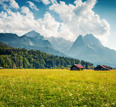 Sunny summer view of Garmisch-Partenkirchen mountain ski resort. Colorful outdoor scene with highest peak of the Wetterstein Mountains, Bavaria, Germany, Europe. I
