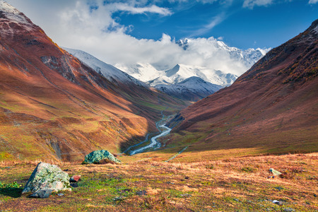 Colorful slopes in the Caucasus mountains. Beautiful outdoor scene with Shkhara Mountain in the Upper Svaneti, Ushguli village location, Georgia, Europe. Artistic style post processed photo.