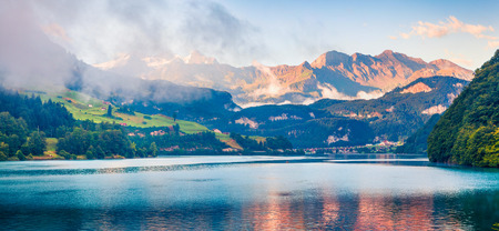 Panoramic view of Lungerersee lake. Colorful summer morning in Swiss Alps, Lungern village location, Switzerland, Europe. Beauty of nature concept background.