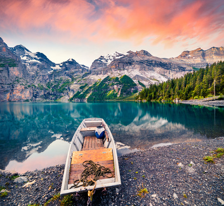 Picturesque summer sunrise on the unique Oeschinensee Lake. Splendid morning scene in the Swiss Alps with Bluemlisalp mountain, Kandersteg village location, Switzerland, Europe.