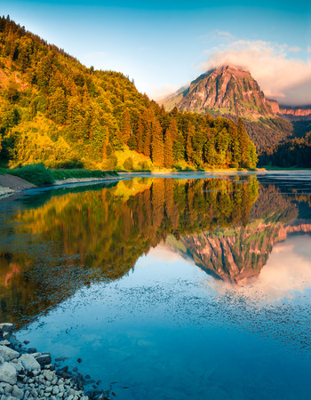 Sunny summer landscape on the Obersee lake. Colorful morning view of Swiss Alps, Nafels village location, Switzerland, Europe. Artistic style post processed photo.