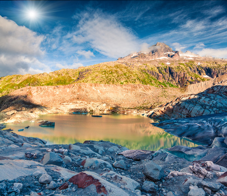Unbelievable summer view of the Rhone glacier. Sunny morning scene in Swiss Alps, Bern canton, Switzerland, Europe. Melting ice in the mountains. Artistic style post processed photo. Stock Photo