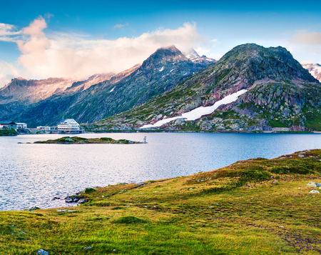Colorful summer evening on the Totensee lake on the top of Grimselpass. Sunny outdoor scene in Swiss Alps, Bern canton, Switzerland, Europe. Artistic style post processed photo.