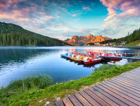 Colorful summer sunrise on the Lake Misurina. Picturesque morning scene in the Tre Cime Di Lavaredo Natural Park, Dolomite Alps, Italy, Europe. Artistic style post processed photo.  Stock Photo