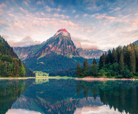 Misty summer landscape on the Obersee lake. Colorful morning view of Swiss Alps, Nafels village location, Switzerland, Europe. Artistic style post processed photo. Stock Photo