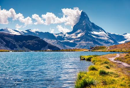 Colorful summer view of the Stellisee lake. Great outdoor scene with Matterhorn (Monte Cervino, Mont Cervin) in Swiss Alps, Zermatt location, Valais canton, Switzerland, Europe. Stock Photo