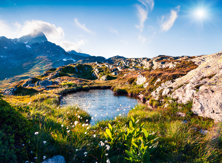 Colorful summer morning near the Totensee lake on the top of Grimselpass. Splendid outdoor scene in the Swiss Alps, Bern canton, Switzerland, Europe. Artistic style post processed photo. Stock Photo