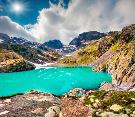 Colorful summer morning on the Lac Blanc lake with Belvedere peack on background, Chamonix location. Beautiful outdoor scene in Vallon de Berard Nature Preserve, Graian Alps, France, Europe.