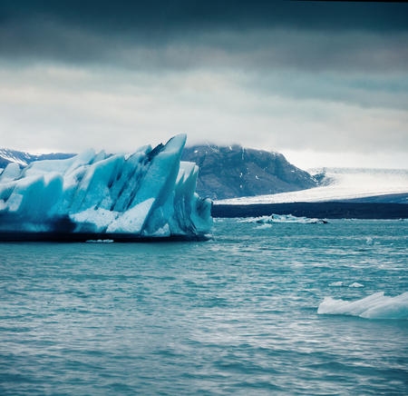 Unbelievable view of floating of blue icebergs in Jokulsarlon glacial lagoon. Dramatic summer morning in Vatnajokull National Park, southeast Iceland, Europe. Artistic style post processed photo. Stock Photo
