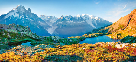 Colorful summer panorama of the Lac Blanc lake with Mont Blanc (Monte Bianco) on background, Chamonix location. Beautiful outdoor scene in Vallon de Berard Nature Preserve, Graian Alps, France, Europe.