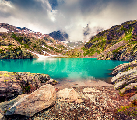 Dramatic summer morning on the Lac Blanc lake with Belvedere peack on background, Chamonix location. Beautiful outdoor scene in Vallon de Berard Nature Preserve, Graian Alps, France, Europe.